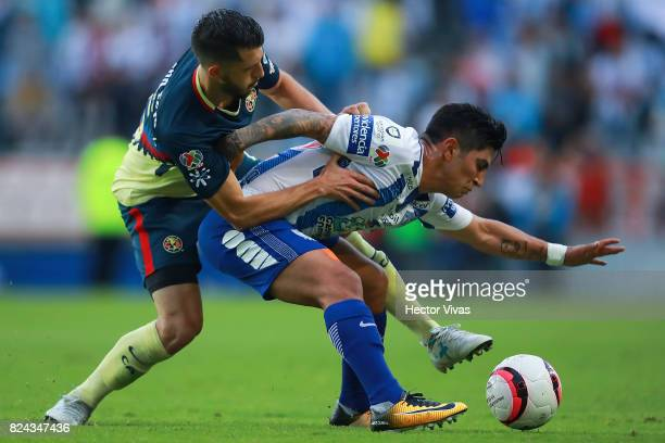 Guido Rodriguez of America struggles for the ball with Victor Guzman of Pachuca during the 2nd round match between Pachuca and America as part of the...