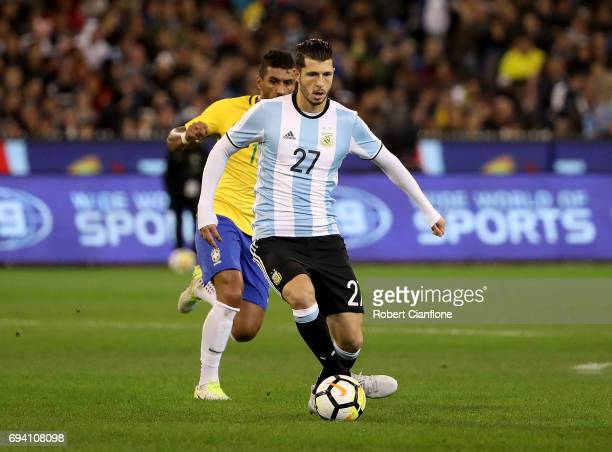 Guido Rodriguez of Argentina runs with the ball during the Brazil Global Tour match between Brazil and Argentina at Melbourne Cricket Ground on June...