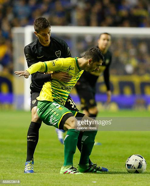 Guido Rodriguez of Defensa y Justicia fights for the ball with Rodrigo Bentancur of Boca Juniors during a match between Boca Juniors and Defensa y...