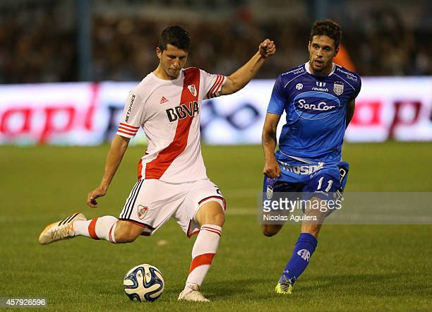 Guido Rodriguez of River Plate fights for the ball with Federico Gonzalez of Atletico Rafaela during a match between Atletico Rafaela and River Plate...