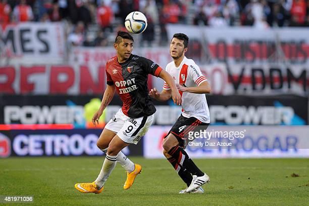 Guido Rodriguez of River Plate struggles for the ball with Alan Ruiz of Colon de Santa Fe during a match between River Plate and Colon de Santa Fe as...