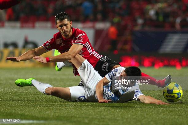 Guido Rodriguez of Tijuana and Hirving Lozano of Pachuca fight for the ball during the 9th round match between Tijuana and Monterrey as part of the...