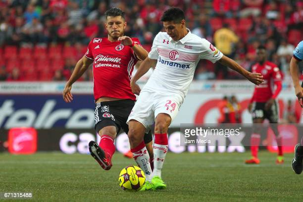 Guido Rodriguez of Tijuana and Pablo Barrientos of Toluca fight for the ball during the 15th round match between Tijuana and Toluca as part of the...