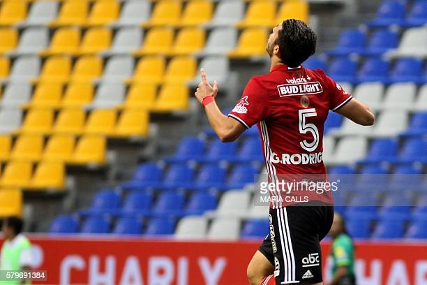 Guido Rodriguez of Tijuana celebrates his goal against Puebla during a 2016 Mexican Apertura Tournament football match at the Cuauhtemoc stadium in...