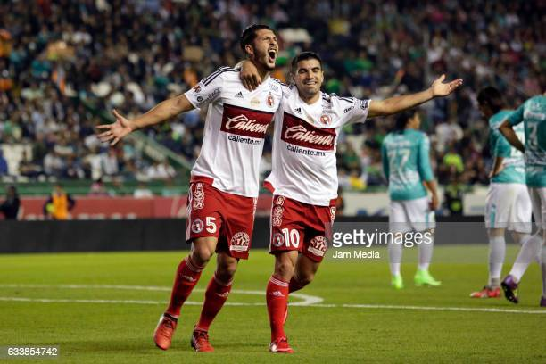 Guido Rodriguez of Tijuana celebrates with teammate Victor Malcorra after scoring the third goal of his team during the 5th round match between Leon...