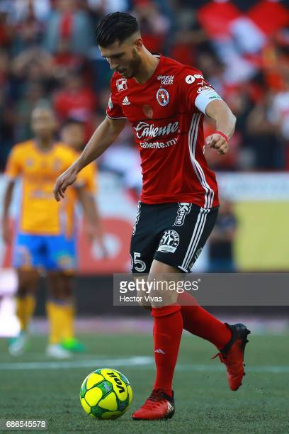 Guido Rodriguez of Tijuana drives the ball during the semi finals second leg match between Tijuana and Tigres UANL as part of the Torneo Clausura...