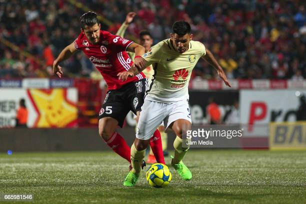 Guido Rodriguez of Tijuana fights for the ball with Silvio Romero of America during the 13th round match between Tijuana and America as part of the...