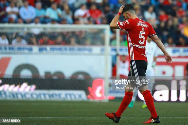 Guido Rodriguez of Tijuana leaves the field after receiving a red card during the semi finals second leg match between Tijuana and Tigres UANL as...