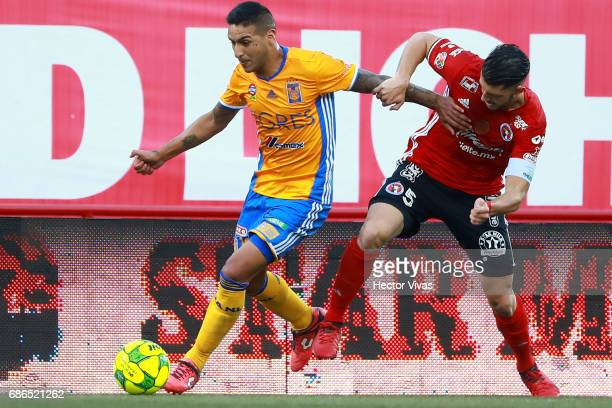 Guido Rodriguez of Tijuana struggles for the ball with Ismael Sosa of Tigres during the semi final second leg match between Tijuana and Tigres UANL...