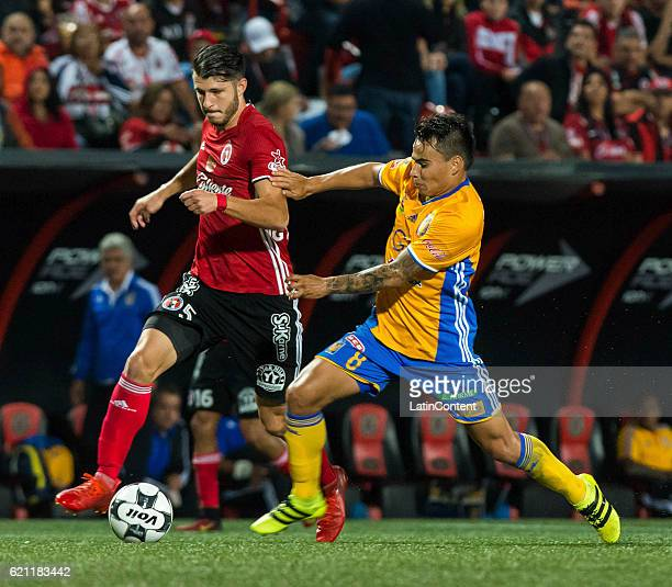 Guido Rodriguez of Xolos fights for the ball with Lucas Zelarayan of Tigres during the 16th round match between Tijuana and Tigres UANL as part of...