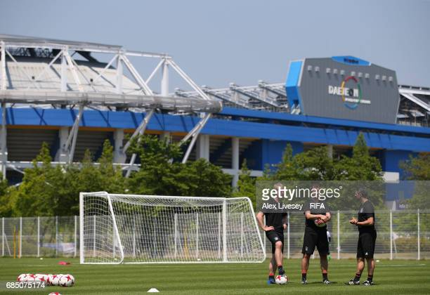 Guido Streichsbier the coach of Germany and his assistants look on during a training session at the Daejeon World Cup Stadium complex ahead of the...
