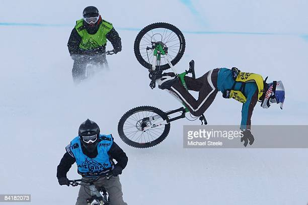 Guido Tschugg of Germany falls from his bicycle behind Johannes Fischbach of Germany during the Fourcross VTT competition on day three of the Tignes...