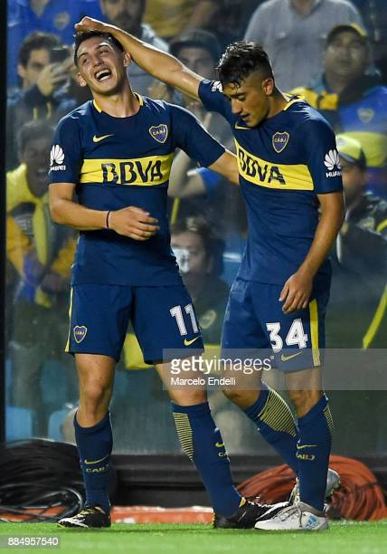 Guido Vadala of Boca Juniors celebrates with teammate Cristian Espinoza after scoring the first goal of his team during a match between Boca Juniors...