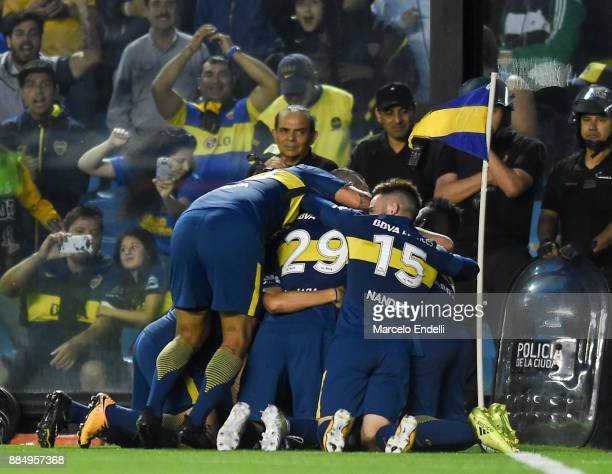 Guido Vadala of Boca Juniors celebrates with teammates after scoring the first goal of his team during a match between Boca Juniors and Arsenal as...