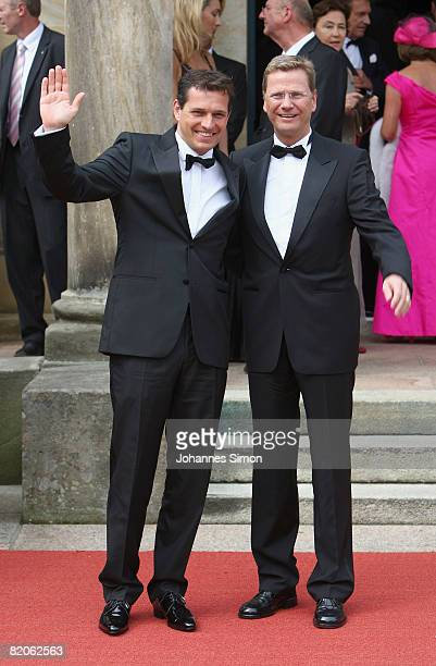 Guido Westerwelle and partner Michael Mronz arrive for the 'Parsifal' premiere of the Richard Wagner festival on July 25 2008 in Bayreuth Germany