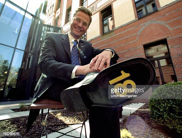 Guido WESTERWELLE chairman of the FDP with ' 18 ' on sole of his shoe