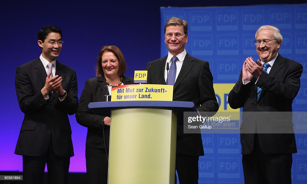 <a gi-track='captionPersonalityLinkClicked' href=/galleries/search?phrase=Guido+Westerwelle&family=editorial&specificpeople=208748 ng-click='$event.stopPropagation()'>Guido Westerwelle</a> (2nd from R), head of the German Free Democrats (FDP) and new Vice Chancellor and Foreign Minister designate, smiles at a special congress of the FDP at former Tempelhof Airport as new FDP designates government ministers (from L to R) new Health Minister designate Philipp Roesler, new Justice Minister designate <a gi-track='captionPersonalityLinkClicked' href=/galleries/search?phrase=Sabine+Leutheusser-Schnarrenberger&family=editorial&specificpeople=3026148 ng-click='$event.stopPropagation()'>Sabine Leutheusser-Schnarrenberger</a> and new Economy Minister designate Rainer Bruederle look on on October 25, 2009 in Berlin, Germany. The FDP was meeting to vote on the proposed coalition contract between the FDP, the Christian Democrats (CDU) and the CDU's Bavarian sister party, the Christian Social Union (CSU), which will make possible the creation of a new German government.
