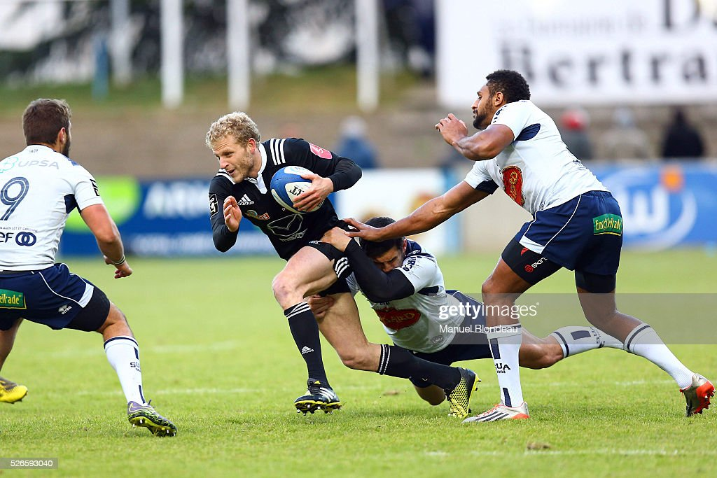 Guilaume Namy of Brive is tackled by Mathieu Lamoulie of Agen during the French Top 14 rugby union match between SU Agen v CA Brive at Stade Armandie on April 30, 2016 in Agen, France.