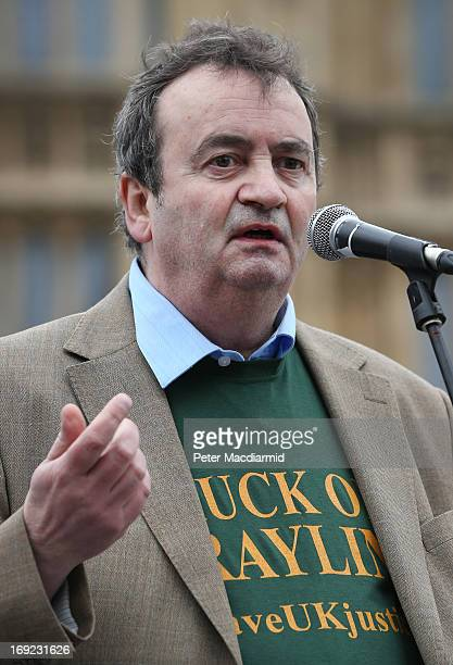 Guildford Four member Gerry Conlon speaks in front of Parliament during a demonstration in support of Legal Aid on May 22 2013 in London England...