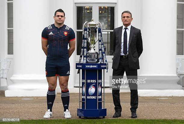 Guilhem Guirado Captain of France and Guy Noves Head Coach of France pose with The Six Nations Trophy during the 2017 RBS Six Nations launch at The...