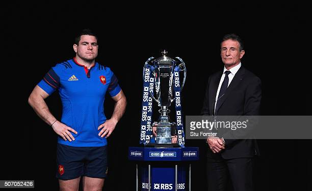 Guilhem Guirado captain of France and head coach Guy Noves pose with the trophy during the RBS Six Nations launch at The Hurlingham Club on January...