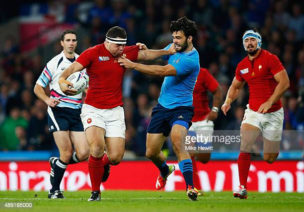 Guilhem Guirado of France hands off Luke McLean of Italy during the 2015 Rugby World Cup Pool D match between France and Italy at Twickenham Stadium...