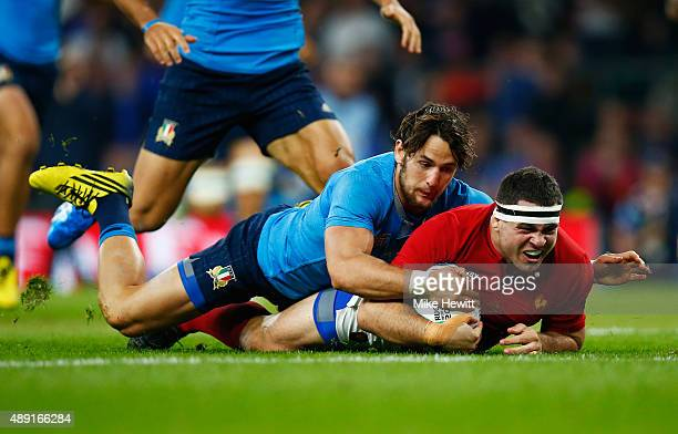 Guilhem Guirado of France is brought down during the 2015 Rugby World Cup Pool D match between France and Italy at Twickenham Stadium on September 19...