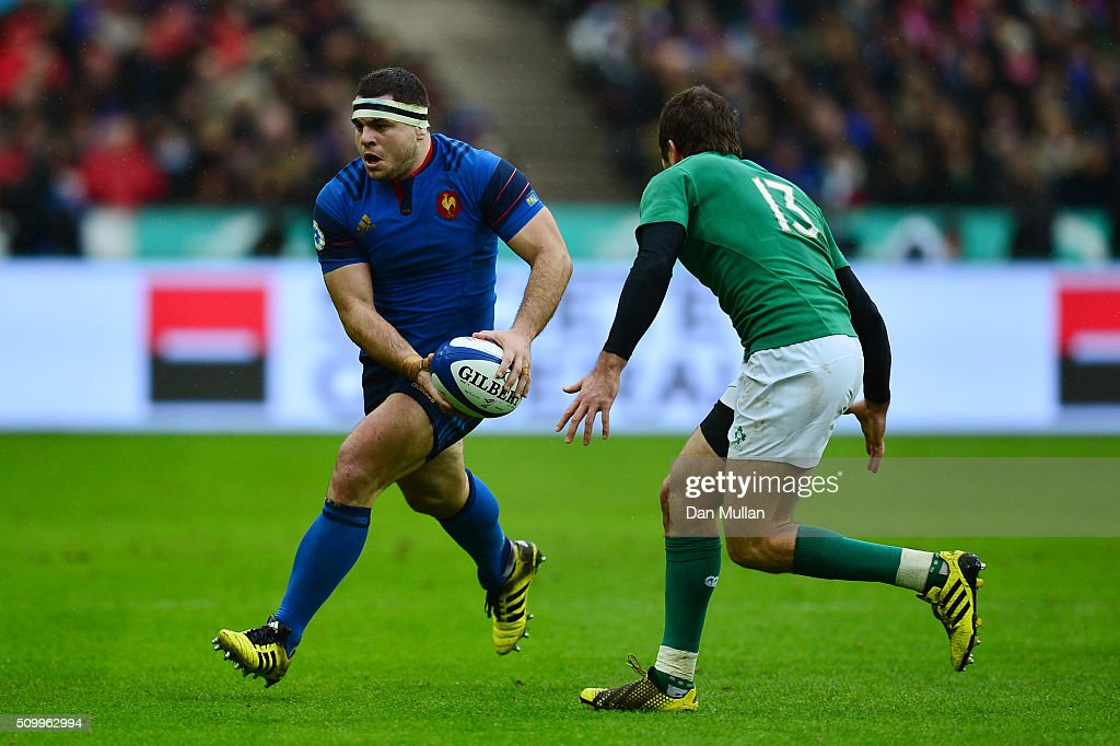 <a gi-track='captionPersonalityLinkClicked' href=/galleries/search?phrase=Guilhem+Guirado&family=editorial&specificpeople=551032 ng-click='$event.stopPropagation()'>Guilhem Guirado</a> of France is challenged by <a gi-track='captionPersonalityLinkClicked' href=/galleries/search?phrase=Jared+Payne&family=editorial&specificpeople=835471 ng-click='$event.stopPropagation()'>Jared Payne</a> of Ireland during the RBS Six Nations match between France and Ireland at the Stade de France on February 13, 2016 in Paris, France.