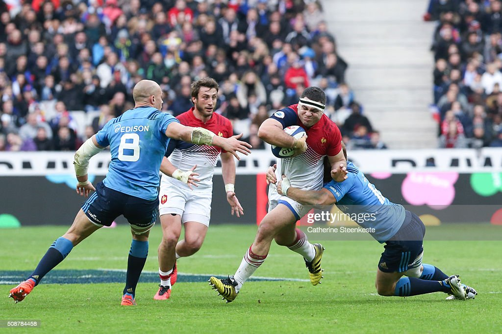 <a gi-track='captionPersonalityLinkClicked' href=/galleries/search?phrase=Guilhem+Guirado&family=editorial&specificpeople=551032 ng-click='$event.stopPropagation()'>Guilhem Guirado</a> #2 of France is tackled by Gonzalo Garcia #12 and <a gi-track='captionPersonalityLinkClicked' href=/galleries/search?phrase=Sergio+Parisse&family=editorial&specificpeople=648570 ng-click='$event.stopPropagation()'>Sergio Parisse</a> #8 of Italy during the RBS Six Nations game between France and Italy at Stade de France on February 6, 2016 in Saint Denis near Paris, France.
