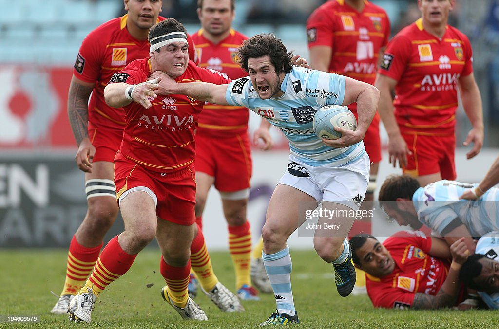 <a gi-track='captionPersonalityLinkClicked' href=/galleries/search?phrase=Guilhem+Guirado&family=editorial&specificpeople=551032 ng-click='$event.stopPropagation()'>Guilhem Guirado</a> of Perpignan and <a gi-track='captionPersonalityLinkClicked' href=/galleries/search?phrase=Maxime+Machenaud&family=editorial&specificpeople=7149115 ng-click='$event.stopPropagation()'>Maxime Machenaud</a> of Racing Metro in action during the French rugby league match (Top 14) between Racing Metro 92 and USA Perpignan USAP at the Stade Yves du Manoir on March 23, 2013 in Colombes near Paris, France.