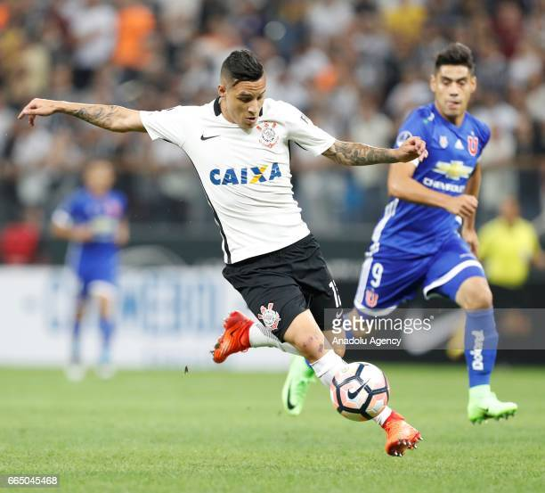 Guilherme Arana of Brazil's Corinthians vies for the ball with F Mora of Chile's Universidad during the Copa Sudamericana match between Corinthians...