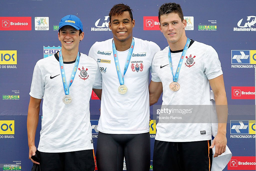 Guilherme Baptistella, Matheus de Santana and Caio Cabrelon Castellan stands on the podium for boys 50m freestyle Junior 1 during Julio Delamare Trophy at Botafogo Aquatic Park on December 07, 2013 in Rio de Janeiro, Brazil.
