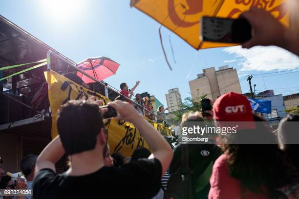 Guilherme Boulos leader of the Homesless Workers' Movement center speaks to demonstrators during a protest against Brazilian President Michel Temer...