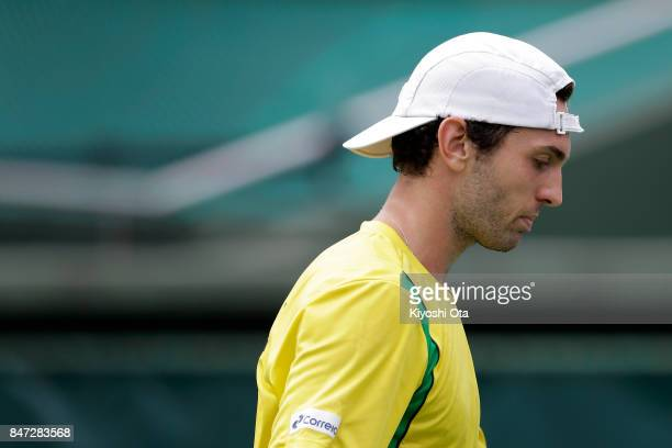 Guilherme Clezar of Brazil reacts in his singles match against Yuichi Sugita of Japan during day one of the Davis Cup World Group Playoff between...