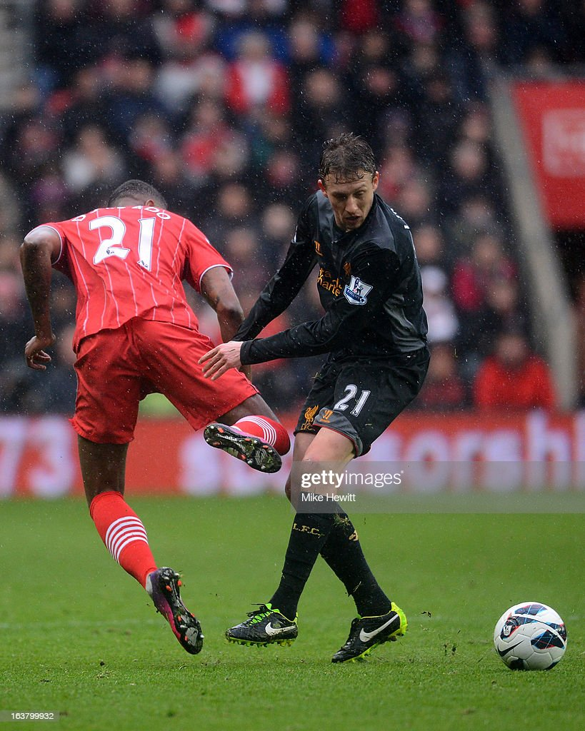 Guilherme do Prado of Southampton clashes with Lucas Leiva of Liverpool during the Barclays Premier League match between Southampton and Liverpool at St Mary's Stadium on March 16, 2013 in Southampton, England.