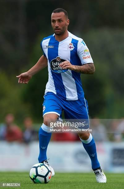 Guilherme dos Santos of Deportivo de La Coruna runs with the ball during the preseason friendly match between Cerceda and Deportivo de La Coruna at O...