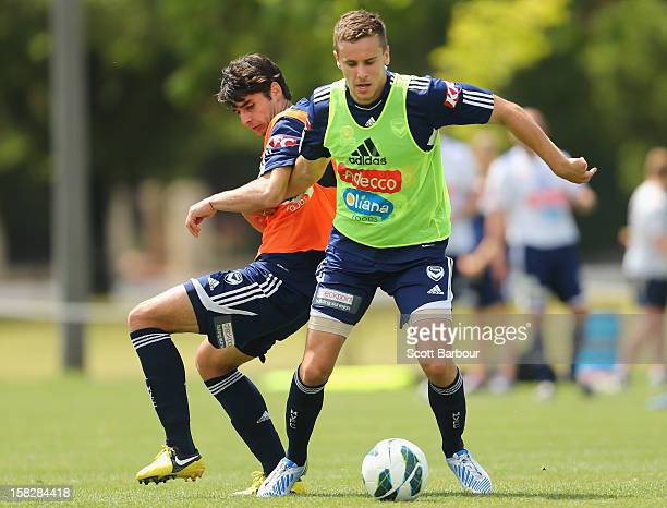 Guilherme Finkler and Petar Franjic of the Victory compete for the ball during a Melbourne Victory training session at Gosch's Paddock on December 13...