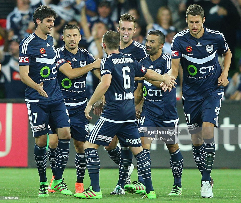 Guilherme Finkler (L) of the Victory celebrates a goal woth teammates during the round 19 A-League match between Melbourne City FC and Melbourne Victory at AAMI Park on February 13, 2016 in Melbourne, Australia.