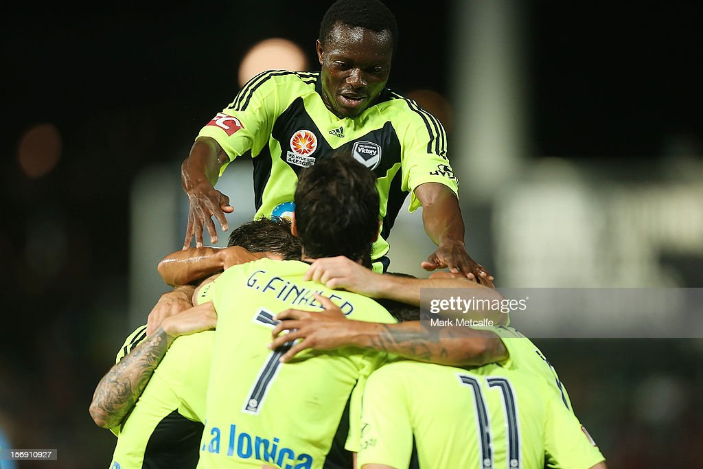 Guilherme Finkler of the Victory celebreates with teammate Adama Traore after scoring during the round eight A-League match between the Western Sydney Wanderers and the Melbourne Victory at Parramatta Stadium on November 24, 2012 in Sydney, Australia.