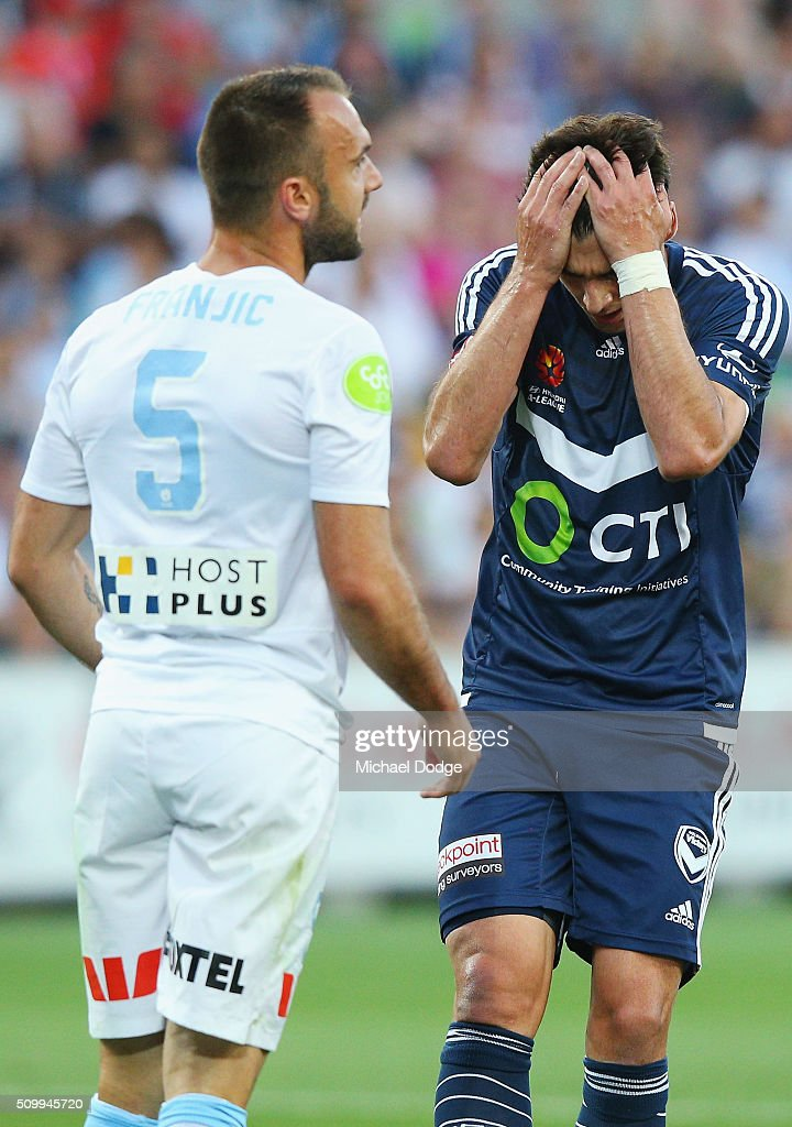 Guilherme Finkler of the Victory reacts after missing a goal next to Ivan Franjic of the City during the round 19 A-League match between Melbourne City FC and Melbourne Victory at AAMI Park on February 13, 2016 in Melbourne, Australia.