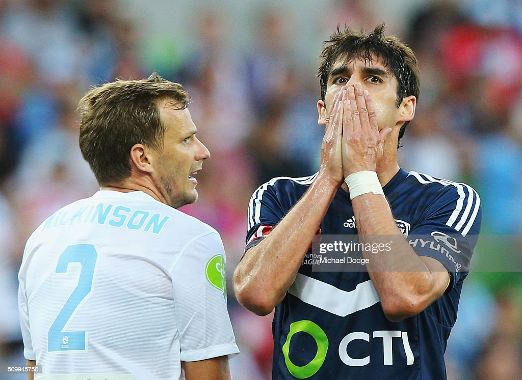 Guilherme Finkler of the Victory reacts after missing a goal next to Alexander Wilkinson of the City during the round 19 A-League match between Melbourne City FC and Melbourne Victory at AAMI Park on February 13, 2016 in Melbourne, Australia.