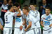 Guilherme Finkler of Victory celebrates with teammates after scoring a goal during the round seven ALeague match between Melbourne Victory and...