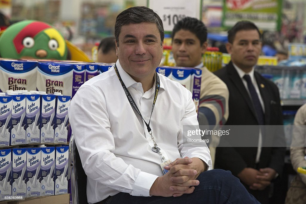 Guilherme Loureiro, chief executive officer of Wal-Mart de Mexico SAB, smiles during an event at a Bodega Aurrera store, the discount chain owned by Wal-Mart Stores Inc., in Naucalpan de Juarez, Mexico, on Wednesday, May 4, 2016. Wal-Mart de Mexico SAB reported first-quarter results last week that beat analysts estimates, the most recent sign of growth for Mexican companies this earnings season. Photographer: Susana Gonzalez/Bloomberg via Getty Images