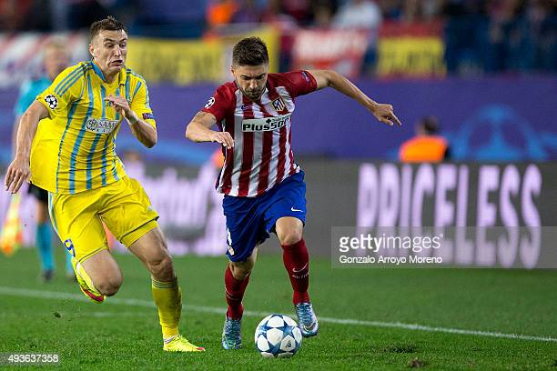 Guilherme Madalena Siqueira of Atletico de Madrid competes for the ball with Aleksei Schetkin of FC Astana during the UEFA Champions League Group C...