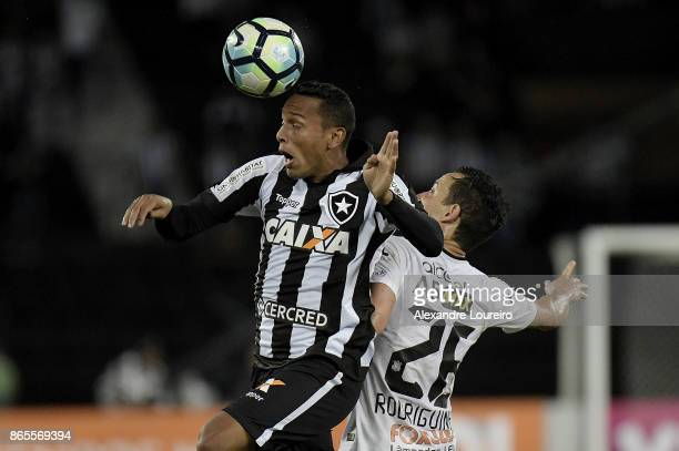 Guilherme of Botafogo battles for the ball with Rodriguinho of Corinthians during the match between Botafogo and Corinthians as part of Brasileirao...