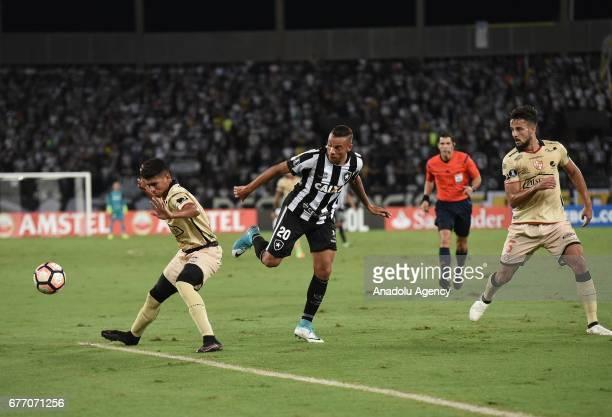 Guilherme of Botafogo de Futebol e Regatas in action against Gabriel Marques of Barcelona SC during Copa Libertadores of America match between...