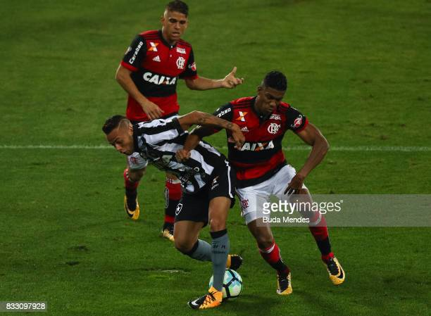 Guilherme of Botafogo struggles for the ball with Orlando Berro of Flamengo during a match between Botafogo and Flamengo as part of Copa do Brasil...