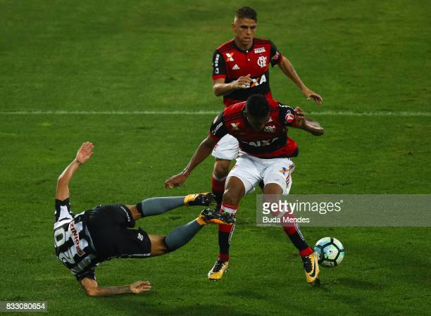 Guilherme of Botafogo struggles for the ball with Rodinei of Flamengo during a match between Botafogo and Flamengo as part of Copa do Brasil...