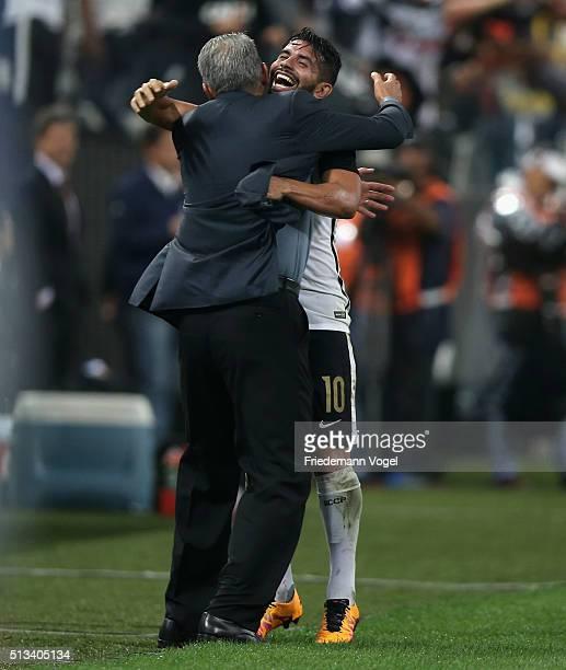 Guilherme of Corinthians celebrates scoring the first goal with his coach Adenor Leonardo Bachi during a match between Corinthians and Santa Fe as...
