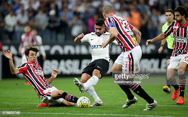 Guilherme of Corinthians fights for the ball with Rodrigo Caio and Maicon of Sao Paulo during the match between Corinthians and Sao Paulo for the...